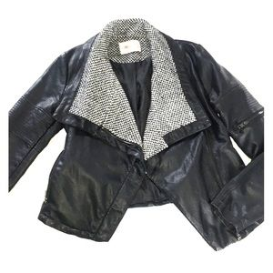 Leather jacket with houndstooth lapel.